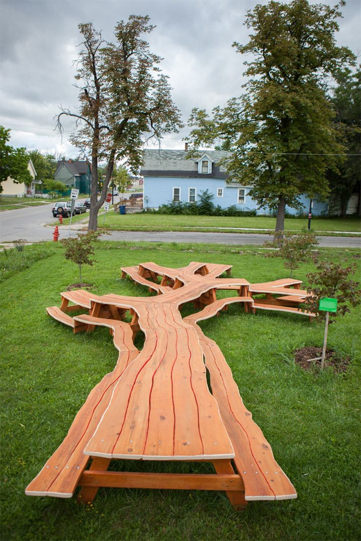 Artist Michael Beitz (previously) designed two more of his amazing sculptural tables in the last year. The first is called Tree Picnic, a functional 50-foot-long picnic table that branches like a tree at the Michigan Riley Farm in Buffalo, NY