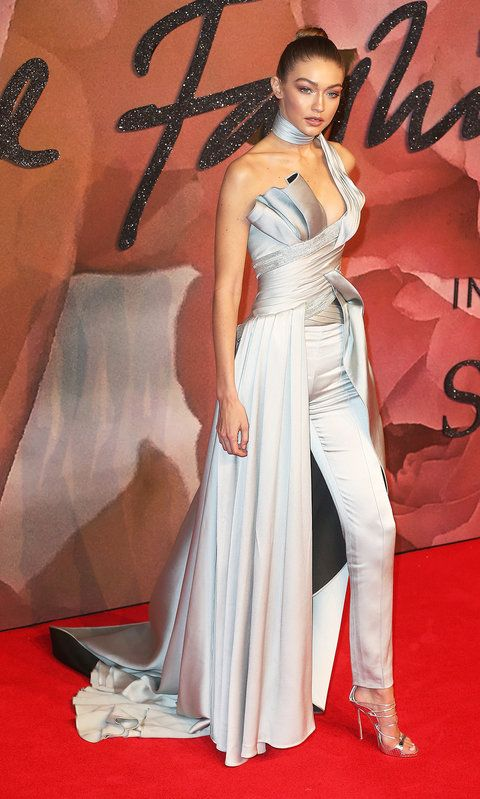 It takes a lot to stand out at an event that celebrates all things fashion, but Gigi Hadid achieved just that when she delivered the most daring look at the British Fashion Awards: a silk seafoam sculpted gown-pant hybrid with a built-in choker, an Atelier Versace creation.