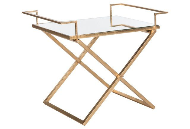 This little gold side table perfectly blends form and function.