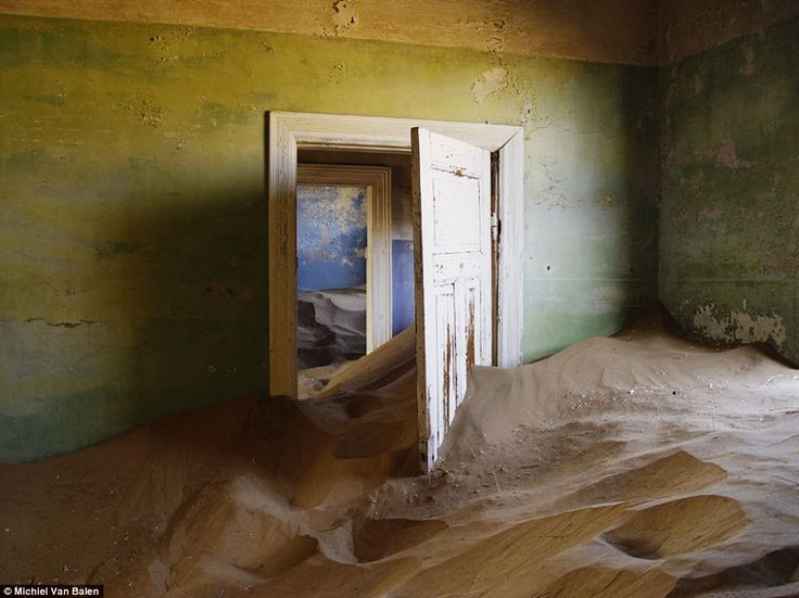 The dunes have trapped the ghost town in time and over the decades have even crept around this door and forcing it open