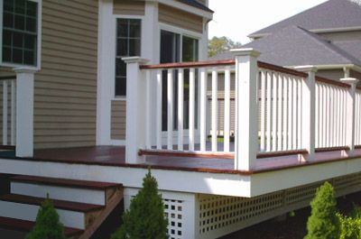 We love the contrast between the mahogany boards and the white rail on this deck!