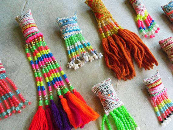 20pcs Vintage embroidered Hmong fabric shapes with beadwork. $20.00, via Etsy.
