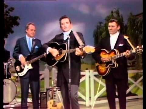 "Johnny Cash performs ""Ring Of Fire"" from 1968 at the Ryman Auditorium, featured on the Grand Ole Opry Vintage Classics DVD. Visit www.opry.com to find out more!"