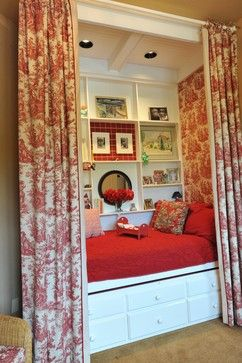 red toile bed in reading nook. I love the Idea of these colors scattered throughout a living room - maybe with a wingback chair covered in that toile fabric