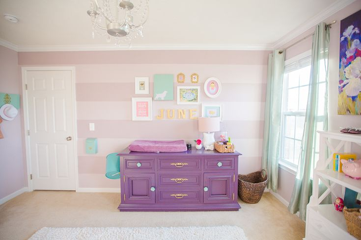 A striped purple, teal and mauve nursery for our baby girl, June. I didn't want to be subjected to a certain nursery theme. If it was pretty, I included it!