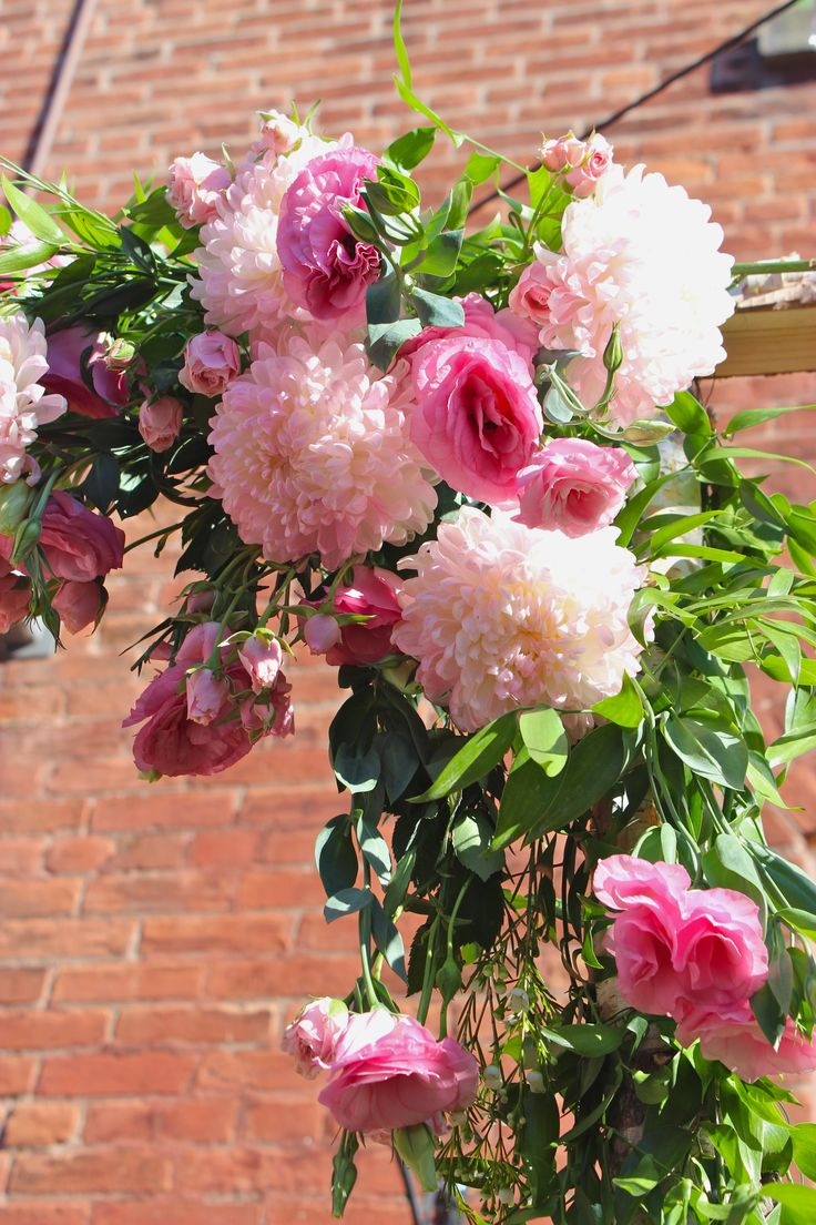 Trellis floral detail shot of beautiful pink blooms and greenery