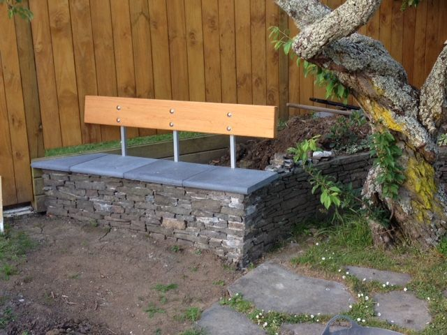 Split stone and macrocarpa raised garden seat built by Barry Hardy