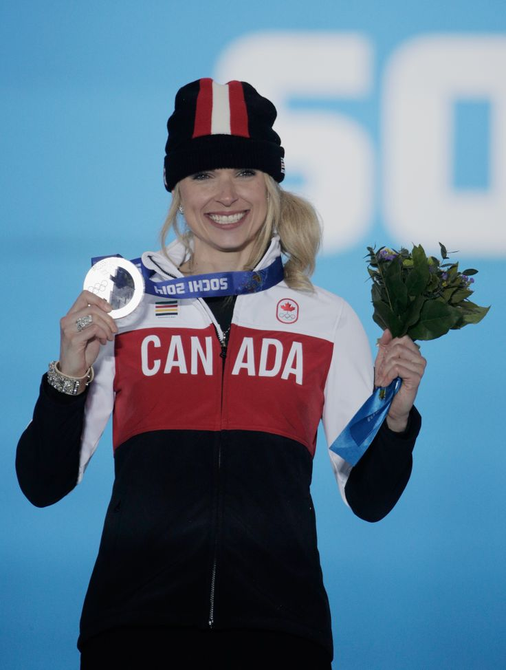 Silver medalist Dominique Maltais of Canada celebrates on the podium during the medal ceremony for the Women's Snowboard Cross (c) Getty Images