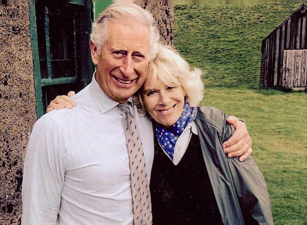 Just the two of us: Charles and Camilla snuggle up as a friend takes a picture of them rel...