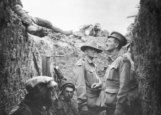 Australian soldiers in captured Turkish trenches at Lone Pine after the battle of 6-9 August 1915. This famous image, also taken by Australian journalist Philip Schuler (see caption for previous image), shows Captain Leslie Morshead, 2nd Battalion (New South Wales) looking up at the dead lying on the lip of the trench and Private James Bryant, 8th Battalion (Victoria), standing looking at the camera. In World War II, Morshead went on to command the 9th Australian Division in the Middle East…