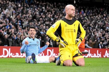 Sergio Aguero (left) celebrates after scoring his team's second goal past Liverpool goalkeeper Pepe Reina