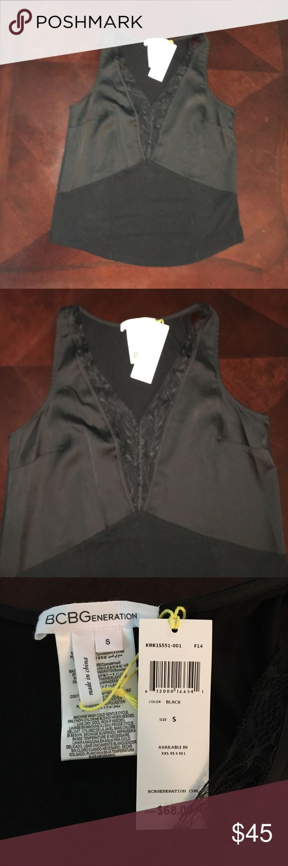 NWT Sexy BCBGeneration Top Sexy Black Lacy Top that has a silk feel around the lace! BCBGeneration Tops Blouses