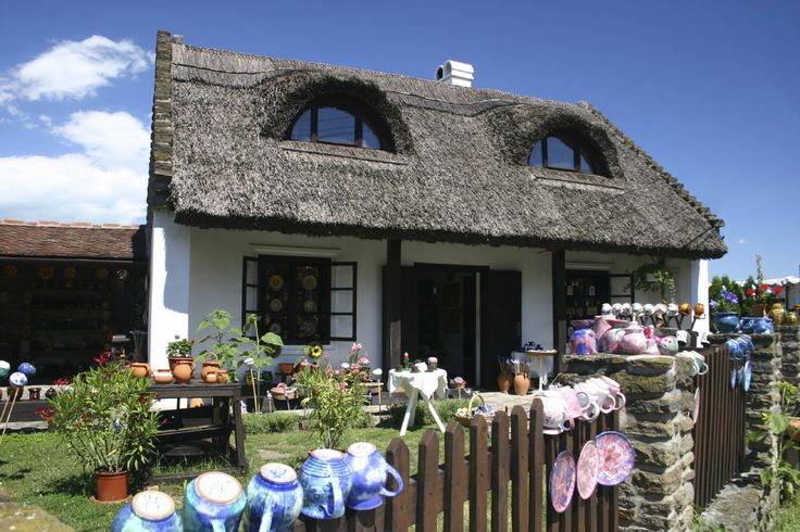 Beautiful old house with thatched roof in Tihany, Hungary -- quaint roof lines help define an idyllic cottage design.