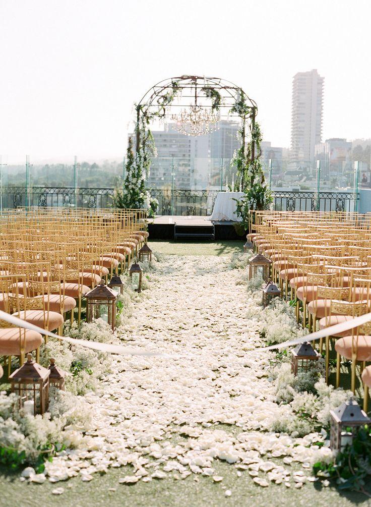 White rose petals blanketing the #aisle Photography: Jose Villa Photography - josevillablog.com