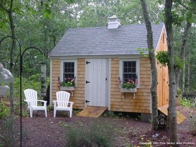 another cedar shake shed with cute door, and window boxes.