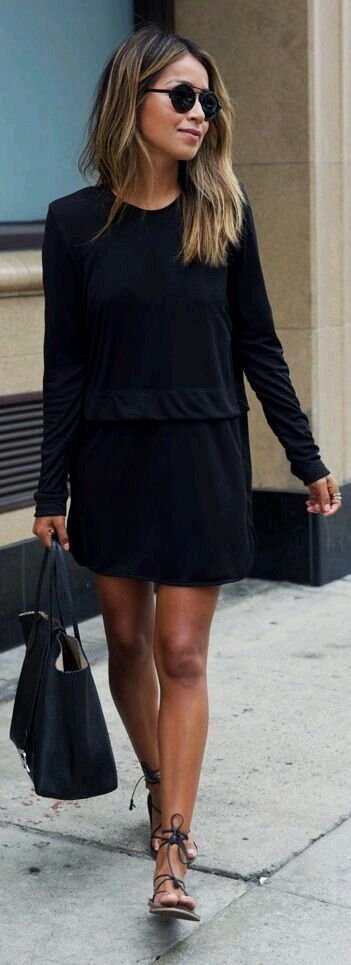 Black loose athleisure dress, tote and flat ankle wrap sandals. Great casual work look or weekend style.