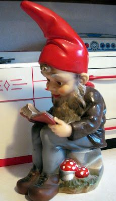 Vintage chalkware gnome reading a book