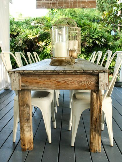 This farm table on the back deck gives Shaun and Shona plenty of opportunities to host al fresco meals.  Farm table, groceries sign: Schil...