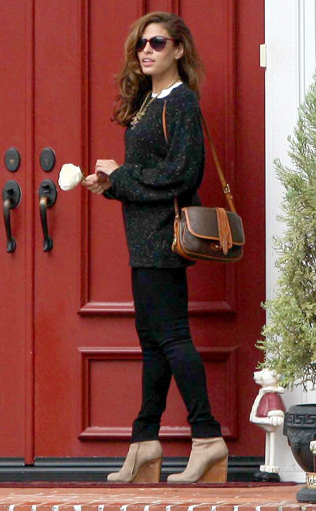 Eva Mendes arrives at a friend's home in Los Angeles wearing a dark gray sweater, black skinnies and beige wedge booties. http://www.eonline.com/photos/6415/celebrity-street-style/237925