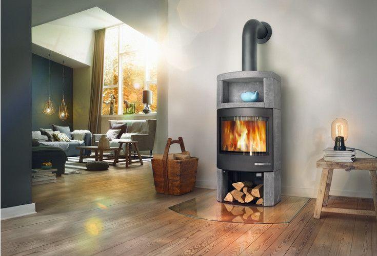 Ator+ to kominek wykonany ze steatytu, materiału który doskonale akumuluje ciepło i ogrzewa salon jeszcze długo po wygaśnięciu pieca.