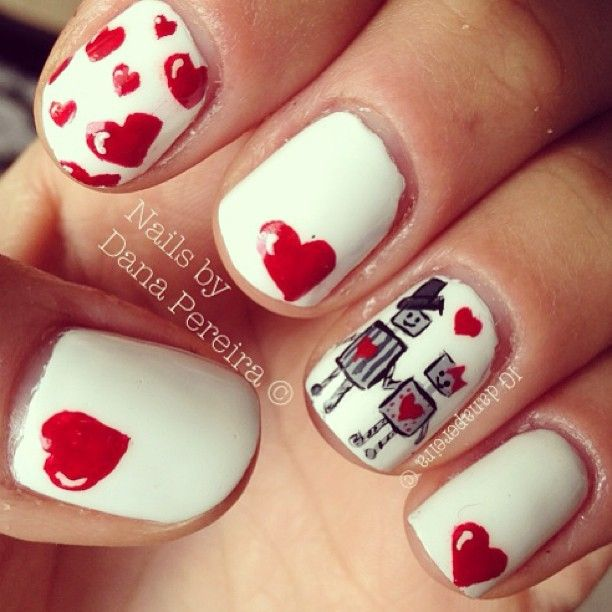 one nail white with red heart, rest of nails red