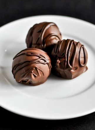 Chocolate Coconut Truffles   Give your guests a dessert to swoon over with these amazing chocolate truffles filled with a sweet, coconut interior.