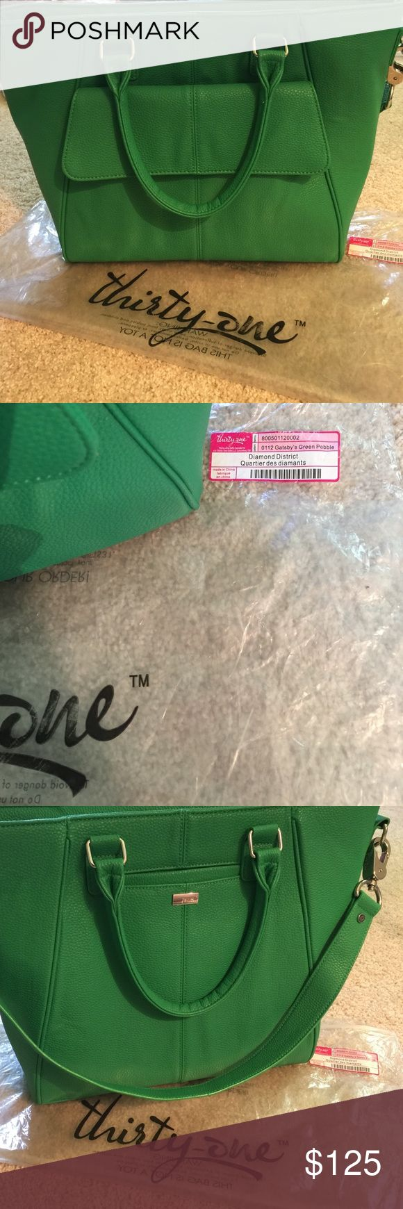 Retired 31 Diamond District Gatsby's Green Pebble Retired Design - Brand New - Never Used - Hidden Exterior Cell Phone Pocket (back) -  bottle pocket (inside) - Two Interior Slip Pockets - Exterior Snap Pocket (front) Thirty-One Bags Satchels