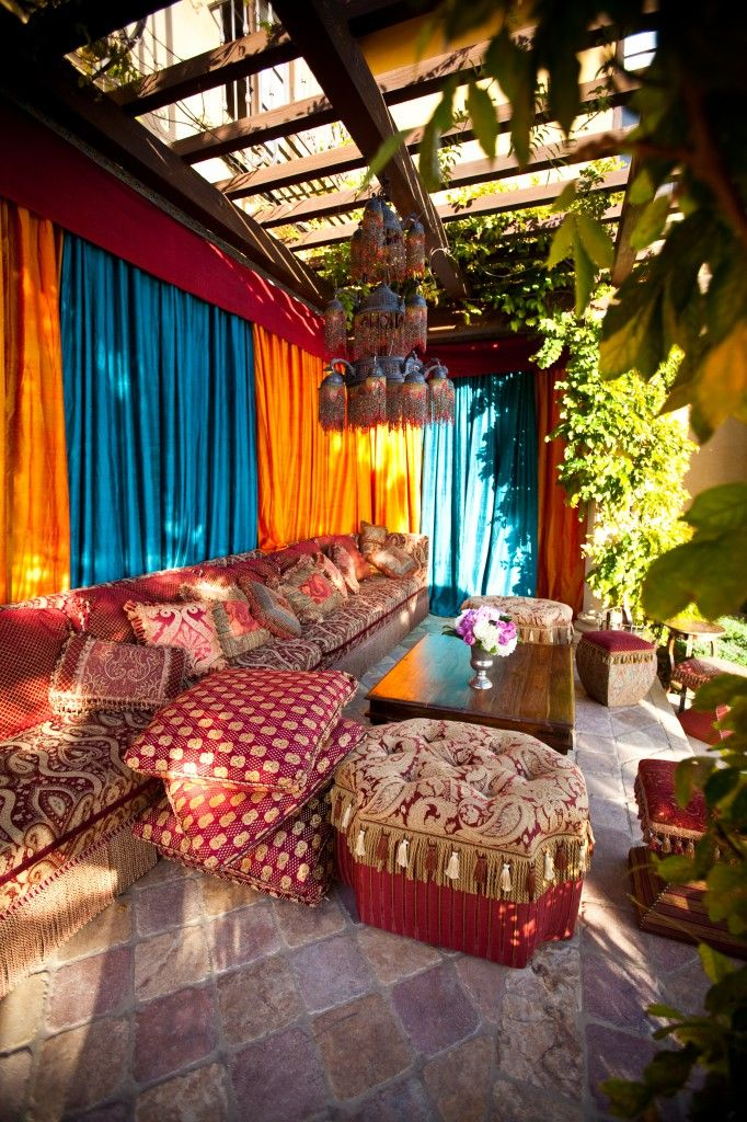 Marakech style patio - so vibrant and cool. I want to drink sweet mint tea and smoke a hookah right now!