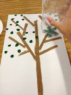 Make an Earth Day Tree out of cardboard and a soda bottle for painting