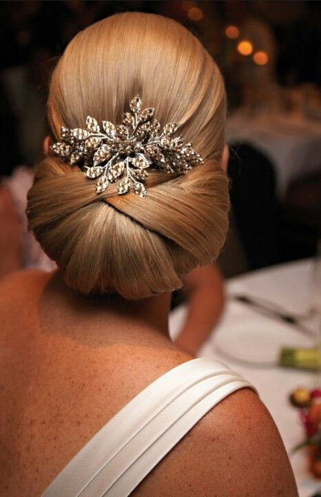 Bride or Mother of the Bride style accented with hair ornament.