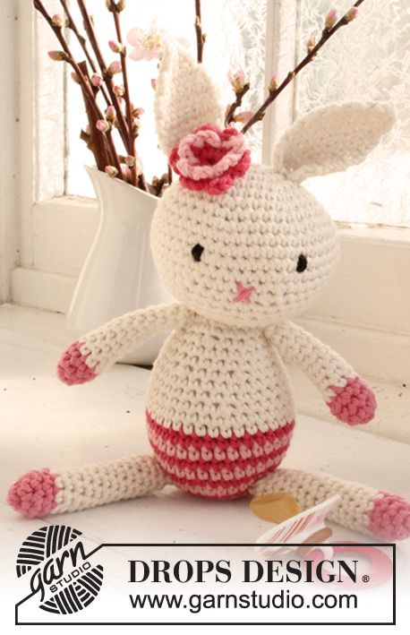 """Crochet DROPS Easter bunny with flower in """"Paris"""". ~ DROPS Design-free pattern available in several languages"""