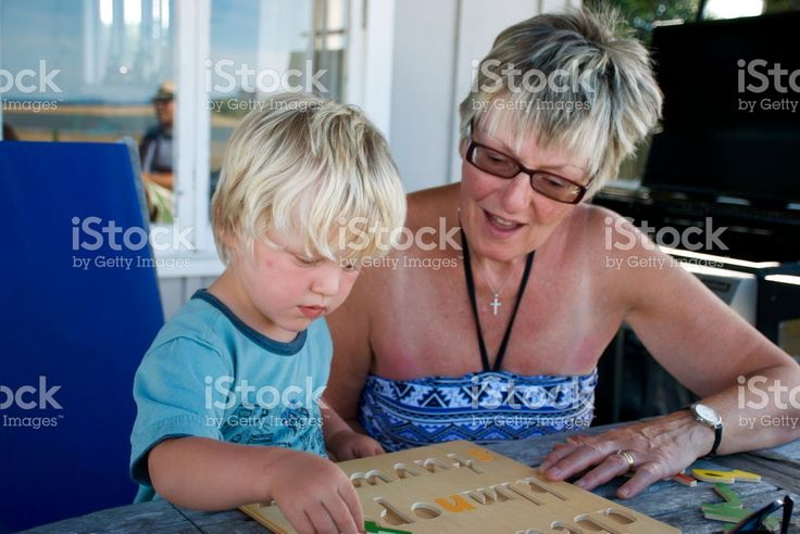 Grandmother helps Toddler with Jigsaw royalty-free stock photo