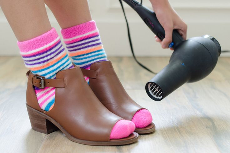 Stretch a pair of tight shoes by wearing thick socks and blow drying the tight area.