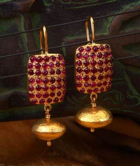 Gehna offer to sell Indo-western pair of earrings features cabochon rubies and gold beads handcrafted in 18k gold online in Chennai.