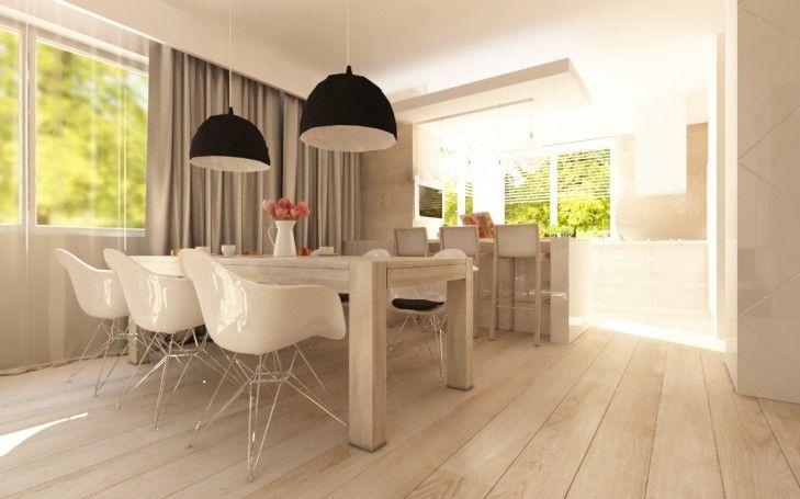 Projekt wnętrz kuchni połączonej z jadalnią w rezydencji w Lesznowoli. Drewniane, jasne meble zostały połączone z czarnymi designerskimi lampami, dodając wnętrzu nowoczesności...