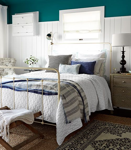 Love this bedroom's beadboard that goes up higher than traditional wainscoting.