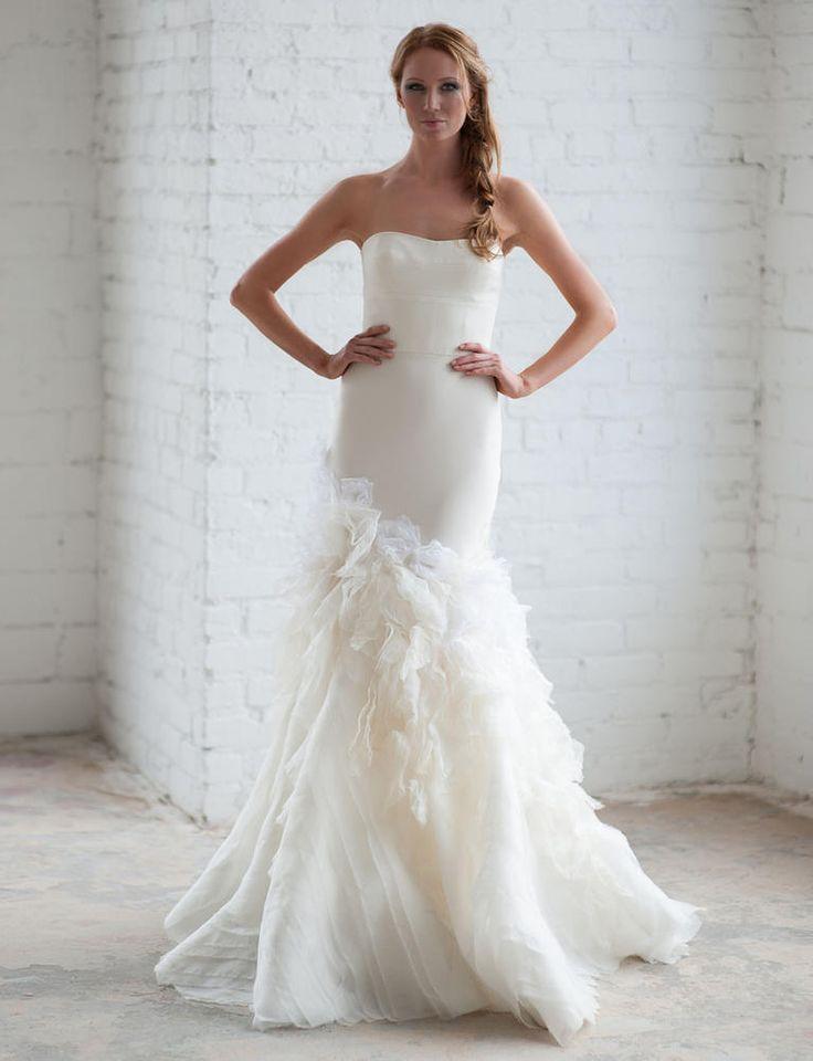 Tara LaTour Fall 2016 white strapless trumpet silhouette with ruffled skirt wedding dress | https://www.theknot.com/content/tara-latour-wedding-dresses-bridal-fashion-week-fall-2016