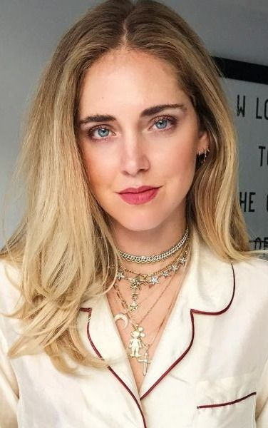 Blogger Chiara Ferragni piles on pieces from her collab with Italian jewelry brand Schield.