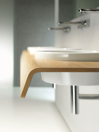 Duravit - Onto  Designer Matteo Thun's Onto washbasin and console ensemble of bonded plywood supporting one or two ceramic sinks-offered in rectangular or round formats. Available in European oak, dark chestnut, matte-white, and matte-basalt finishes, the console is oiled and waxed to prevent warping. Surfaces can also be fitted with openings for towels. Other options in the series include drawers, a tub, and a cabinet.  888-387-2848; duravit.com