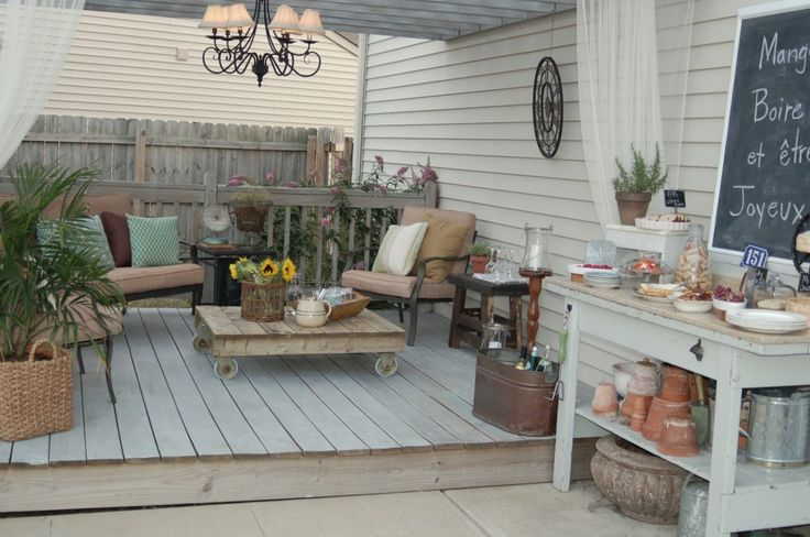 I like the look of a raised deck-like section built on the patio foundation - under a covered roof, it makes a very porch-like look, especially with wood railing around - have to keep this in mind - a DIY porch where there is none! +++++++++++++++++ unexpectedelegance.com #porch #patio