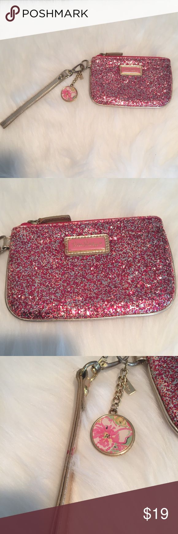 Lilly Pulitzer pink and silver glitter wristlet Lilly Pulitzer pink and silver glitter wristlet 6x4. Has some damage on straps (see pictures). Zipper is functional and super cute. Lilly Pulitzer Bags Clutches & Wristlets