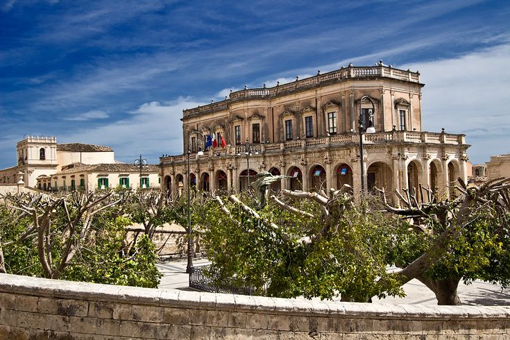 """Palazzo Ducezio (Town Hall) in Noto, Sicily. Noto, a UNESCO World Heritage Site, is nicknamed """"the Stone Garden"""" for its many stone buildings constructed in Sicilian Baroque style."""