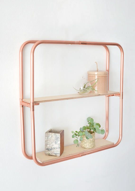 This copper (rose gold colour) wall shelf is ideal to add a little something special to any wall in your home, studio or shop. Varnished Birch Plywood shelves sit on a beautiful copper frame. Fix to your wall as photographed or stand on a table. Designed and made in Brighton, UK by Little Deer  Use the shelf space to display books, plants, ornaments, photos or anything you desire.  Each piece is made to order from industrial copper pipes and fittings. Once finished the copper will be sanded…