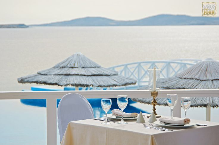 The table has been set and the view is purely awesome! Bon Appétit! saintjohn.gr