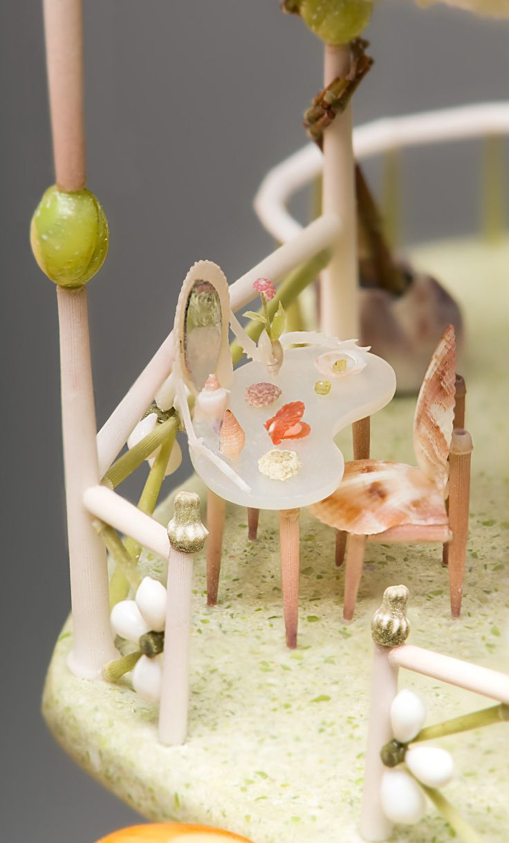 peter-gabriel-miniature-mermaid-dollhouse: On the mother-of-pearl dressing table there are cosmetic bottles made of tiny shells and sea urchins, a red scallop powder compact and a pair of olivine sand ear rings.