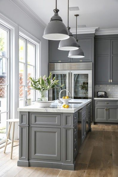 Grey looking elegant and purposeful...sophisticated kitchen making the best of the large amounts of light received from the windows.