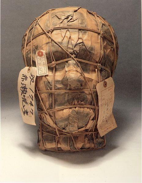 Creepy idea for your haunt. I really really love this. Styrofoam head, papier mache, basting string, tags...