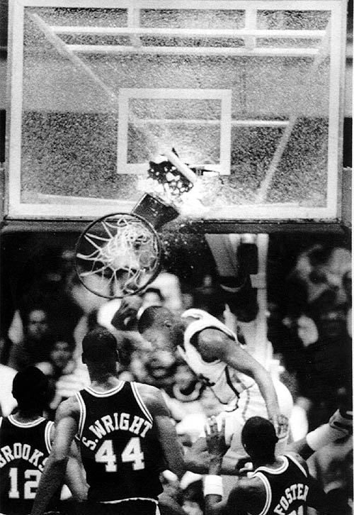 """On January 25, 1988 in a college basketball game featuring Jerome Lane's Pittsburgh team playing Providence on a national television broadcast, he broke the glass backboard with a one-handed dunk with Sean Miller assisting on the play. Often referred to simply as """"The Dunk"""", the play was famously called by color analyst Bill Raftery when he exclaimed """"Send it in, Jerome!!"""" The play is on ESPN's list of the """"100 Greatest Sports Highlights."""" #CollegeVault"""