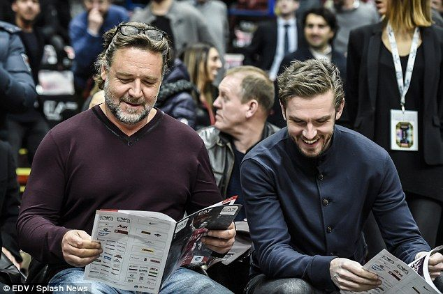 Broad shoulders: New Zealand-born actor Russell Crowe, 51, (left) looked buff at a basketball game in Assago, near Milan, Italy, on Tuesday - joined by Downton Abbey star Dan Stevens, 33, (right)