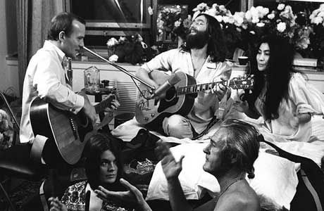 Tommy smothers john amp yoko and timothy leary in foreground